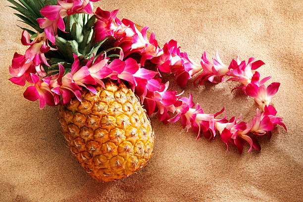 lei on pineapple at the beach